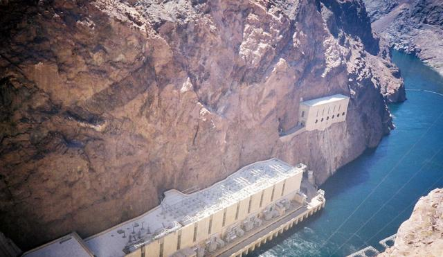 Looking down the face of the Hoover Dam at the Colorado River flowing