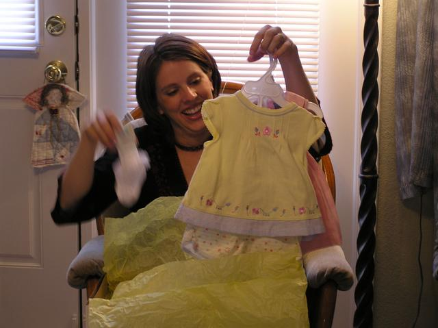 Kathy gazes upon more girly outfits with glee