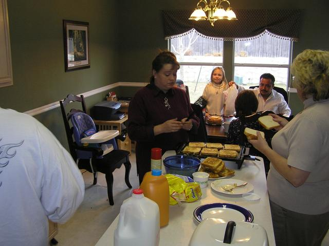 Christie and Grandma create more French toast as Jason's daughter Bailey, Kathy, and Christie's husband Christpin enjoy some barbacoa breakfast tacos.